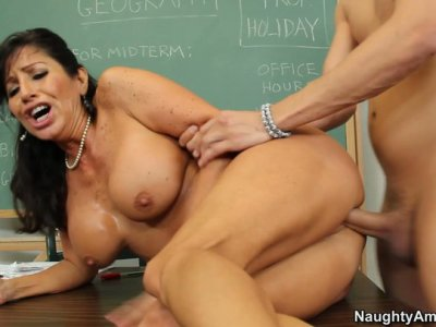 Slutty brunette teacher Tara Holiday rides her student in the class